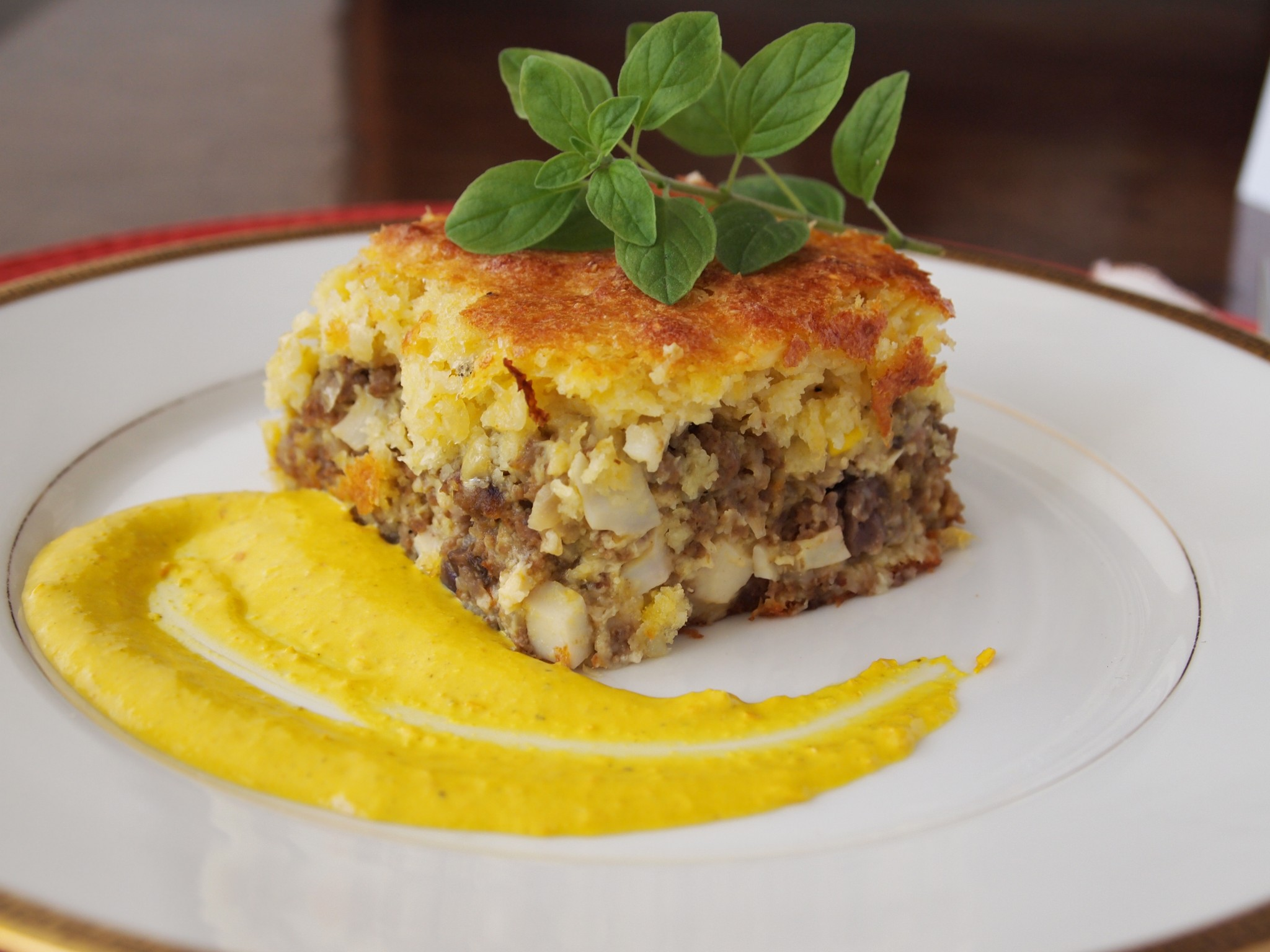 Corn pie, stuffed with beef, raisins, black olives and boiled eggs.
