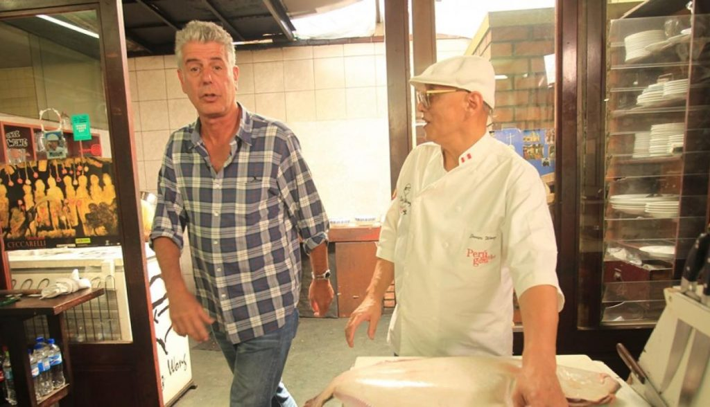 Anthony Bourdain and Peruvian Chef Chez Wong cooking ceviche in Lima, Peru