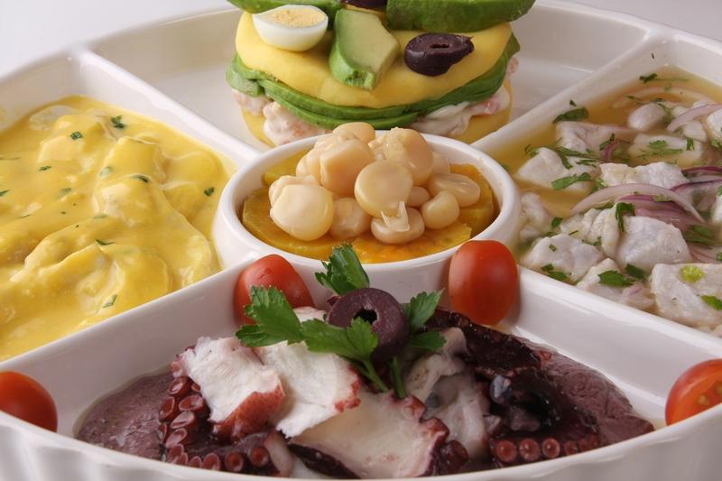 Piqueo Peruano - Ceviche, octopus in black olive sauce, tiradito, causa